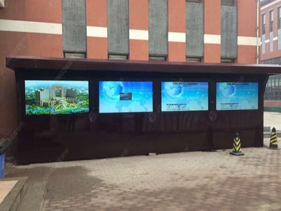 天津权健集团70寸壁挂式广告机